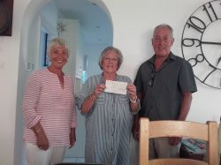 Cheque presentation to 'Shelters' Committee