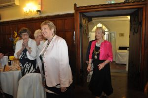 DC Hazel entering the Ruby Room with Assn. President Trish