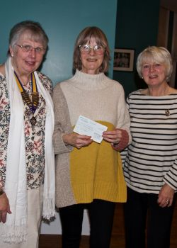 Speaker Caroline Jones receives a donation to 'Cheerful Sparrows'