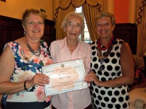 Jean, Rose and Hazel with certificate