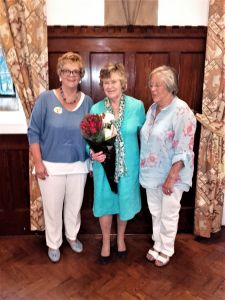 Liz Hobcraft with flowers and the two Presidents