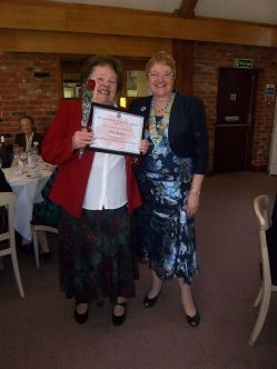 Olive Dickins from Westerham is given 50 yrs certificate