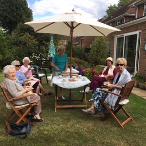 Small group tea party in a members garden