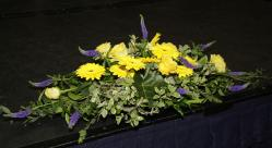 The large floral arrangement on the top table.